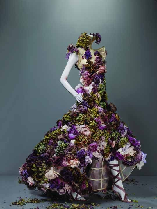 "the dress made from real flowers from alexander mcqueen's spring 2007 collection ""sarabande"" featured here in the mcqueen 'savage beauty' exhibit at the MET this is one of my favourite designs by mcqueen and probably my favourite dress by any designer. when tanya dziahileva wore it during the runway show petals were falling off as she walked, it was so beautiful ""Things rot. It was all about decay. I used flowers because they die"".- Alexander McQueen"