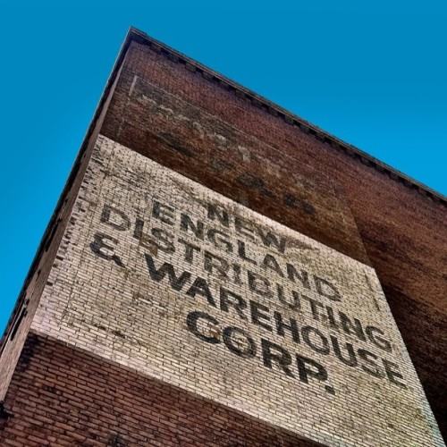 "This sign is on an old warehouse in the Charlestown Navy Yard not far from the USS Constitution. I believe it was most recently used by Borden Candy (which was later bought out by NEECO). More interesting is the barely readable ""White Star"" near the top. I'm not sure what was going on here 100 years ago, but the White Star Line was a notable British shipping company which built some damn famous vessels, including the Titanic."