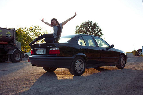 photo: I got a new car! This is a '92 bmw 325i. As you can see, I am thrilled with it. I'm really amazed at how much my thinking about driving has already shifted in the last few days. It shifted on day one, actually. It's difficult to drive slowly. I get mad at people who get in my way on sharp turns. Who am I? What's going on with me?