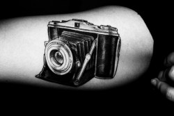 fuckyeahtattoos:  I love to photograph, my grandfather knew so he gave me his first camera. I got this tattoo after my grandparents died.