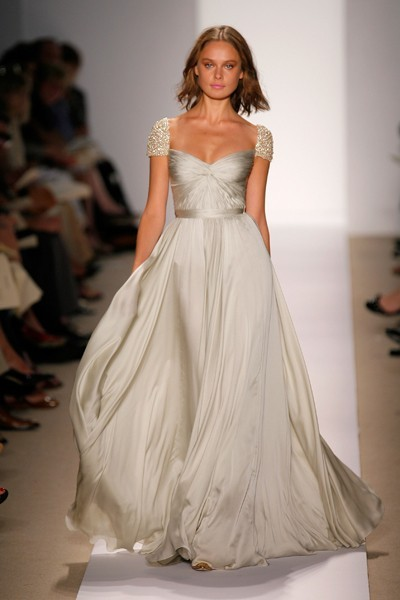 Love this Reem Acra wedding dress! The beautiful beaded sleeves and the gorgeous way it moves! LOVE. (via Pinterest)