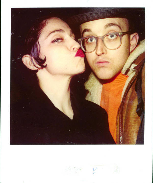 "Madonna and Keith Haring polaroid. ""He, Jean-Michel, Kenny and Madonna started a club together. She and Keith were best of friends because he generated that energy and Madonna then was really mostly a dancer. It was a remarkable art club they created, with performances Saturday mornings, science fiction movies, and one-day art shows. The Paradise Garage was where Madonna had her first performance. When she did 'Like A Virgin' they created a pink satin bed, tilted forward towards Diana Ross, who was watching maybe 2-feet away."""