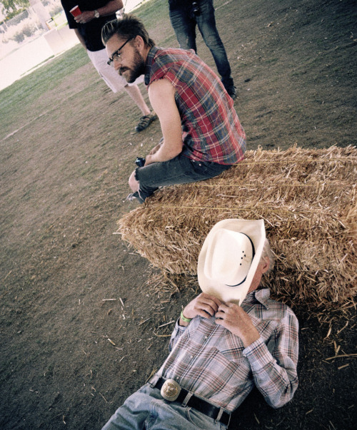 An old man rests as another man looks on at Stagecoach Music Festival 2011.
