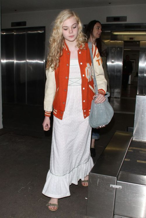 suicideblonde:  Elle Fanning arriving at LAX, May 3rd This outfit is adorable!  Ugh, once again this girl is my style icon.