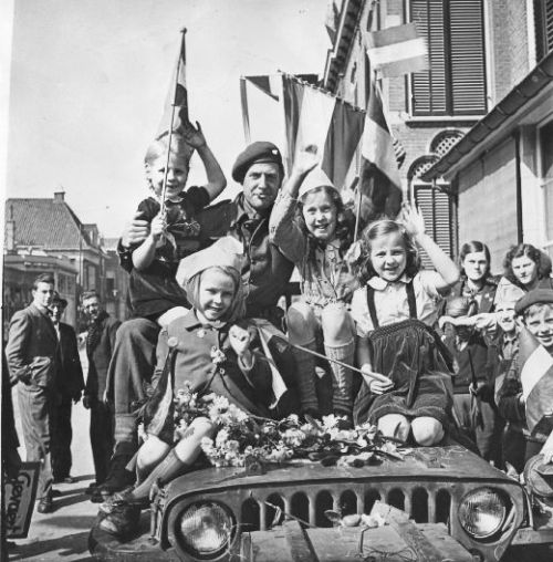 demons:  Children celebrate the surrender of the remaining German forces in the Netherlands with their Canadian liberators, May 5 1945