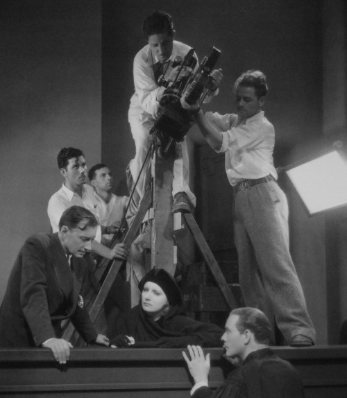 "Greta Garbo and Conrad Nagel being directed by Jacques Feyder and photographed by William Daniels in Greta's last silent film, The Kiss (1929)Photograph by Milton Brown   ""In spite of her stubborn silence in this talkie day, I would gladly pay for my own ticket to see a Garbo picture—which is the greatest compliment a reviewer can pay.""Motion Picture magazine"