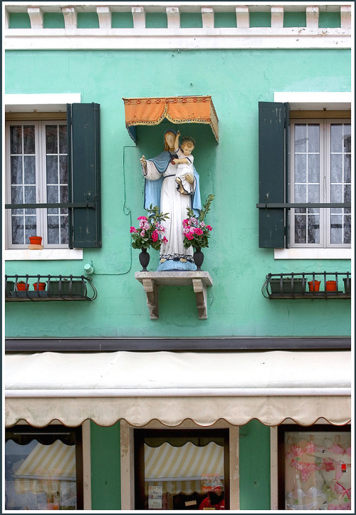 Public shrine above a lingerie and bikini shop in Burano, an island close to Venice.Source