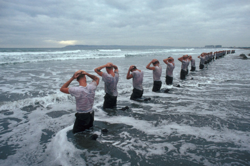 "Some highlights from the Navy SEAL workout: getting ""drown-proofed"": swimming with bound arms and legs ""surf torture"" (official name: water immersion): a prolonged bob in the 60-degree Pacific Ocean jumping on and off a pier while being hosed down with cold water retrieving a raft from a distant shed and supporting the 150-pound object—packed with paddles and gear—on your head ""Hell Week,"" a five-day regime of simulated battle stress—and less than four hours of sleep a night more than 150 miles of swimming more than 1,300 miles of running over the full six months training"