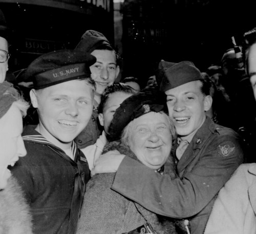 todaysdocument:  May 7, 1945 - Celebrating Germany's Surrender: Jubilant American soldier hugs motherly English woman and victory smiles light the faces of happy service men and civilians at Piccadilly Circus, London, celebrating Germany's unconditional surrender. England, May 7, 1945.