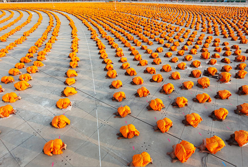 A mass ordination of 34,000 monks at Wat Phra Dhammakaya, Thailand by Luke Duggleby, honored as Travel Photographer of the Year (The Guardian, via kateoplis)