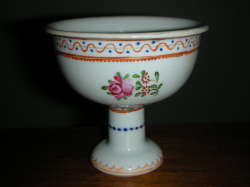 This stem cup is thicker than the standard ones. Conservative date, 19th century.