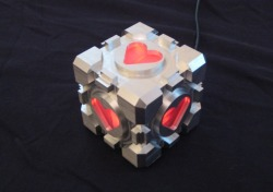 justinrampage:  The Portal Companion Cube has come to life thanks to DIY mechanical engineer Jamie Nasiatka. It lights up, changes colors and even keeps you company while you sleep. Check out the detailed build process HERE. Weighted Companion Cube by Jamie Nasiatka Via: Engadget