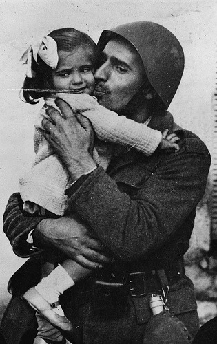 Unidentified Greek soldier holding his daughter during WWII.