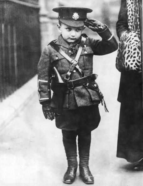 A young man saluting in his own miniature copy of a WWI British army uniform. Adorable. Source: Life
