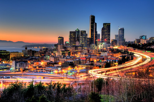 30 Seconds of Seattle by moog55 on Flickr.Via Flickr:View LARGE Version for Greater Detail This shot is a result of the first shoot that I did after I bought my D90.  It was an unusual day for Seattle given that it was the middle of January and it was perfectly clear and not raining.  Given how the sun was setting that time of year, the reflections off the side of the buildings were even more pronounced than they are at other times.  The other advantage to shooting this in January is that you're afforded a mostly clear shot since most of the trees in the foreground were without leaves.