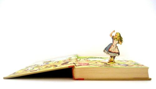 Alice in Wonderland coming out of her own story book.