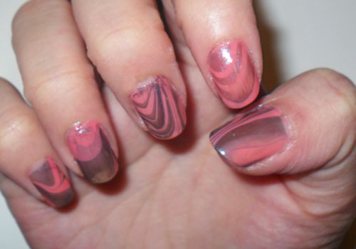 Experiment! Coral and Grey Marbled Nails —- Decided to try nail marbling. I armed myself with a coral pink polish and gunmetal metallic grey. Then with a bowl of water, lots of tape, and a handful of toothpicks, I set to work.  —- Probably going to experiment with different textures, base coat shades, etc. But all in all, not bad for a first-try!