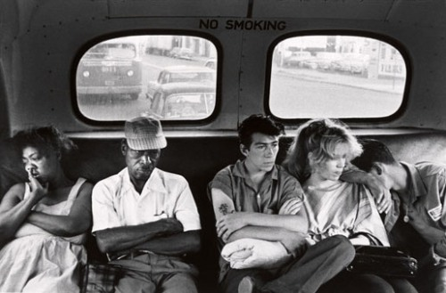 © Bruce Davidson, 1959, 'Brooklyn Gang', New York City / USA During the African-American Civil Rights Movement (1955-1968) photographer Bruce Davidson read about a Brooklyn Gang called The Jokers. He followed them around documenting their lifestyle. Davidson captured this image of three of the gang members sitting in the back of a bus with an African-American couple, while segregation on buses was still in place. Perhaps the gang considered this as a rebellious action, but I find it to be incredibly humane. (thanks forgottengroup) » find more of Magnum Photos here «
