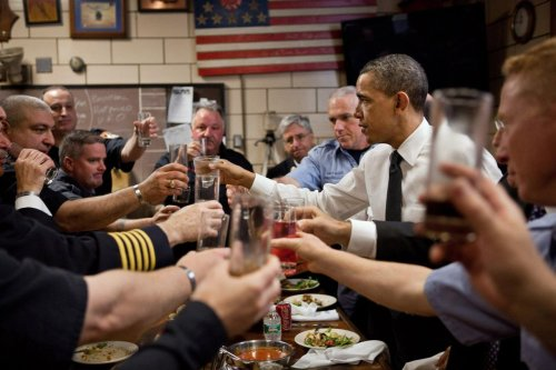 "President Barack Obama and firefighters toast during a lunch at Engine 54, Ladder 4, Battalion 9 Firehouse in New York, N.Y., May 5, 2011. The firehouse, known as the ""Pride of Midtown,"" lost 15 firefighters on 9/11 — an entire shift and more than any other New York Firehouse. The 15 men killed had 28 children between them. via wh.gov/photogallery"