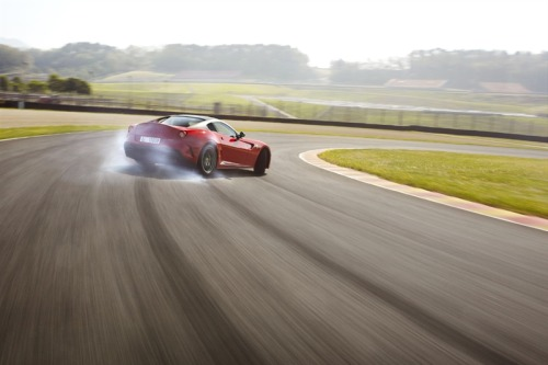 photofinish:  599 GTO  Turn off driver's assists. Drive the car.
