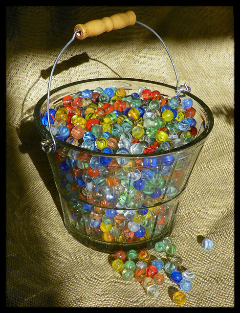 Bucket of Marbles by Dusty_73 on Flickr.