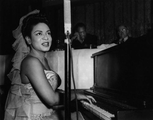 Hazel Scott (with Paul Robeson in the background) performing at a dinner in Brooklyn in honor of Hugh Mulzac, the first African American captain in the U.S. Navy to command an integrated crew during World War II.
