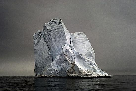 "GLOBAL WARMING ""The Last Iceberg chronicles just a handful of the many thousands of icebergs that are currently headed to their end. I approach the images of icebergs as portraits of individuals, much like family photos of my ancestors. I seek a moment in their life in which they convey their unique personality, some connection to our own experience and a glimpse of their soul which endures."" - Camille Seaman via Camille Seaman via Josh Spear"