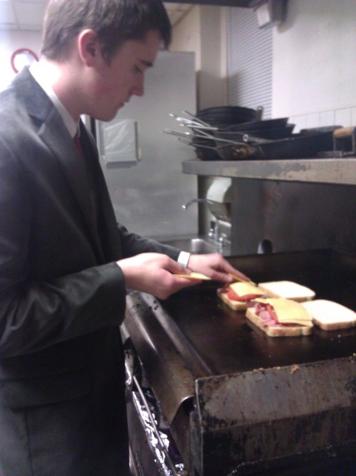 3/18/2011 Making some tomato, ham grilled cheese after the Alpha Delta Phi Literary Event. Classy.