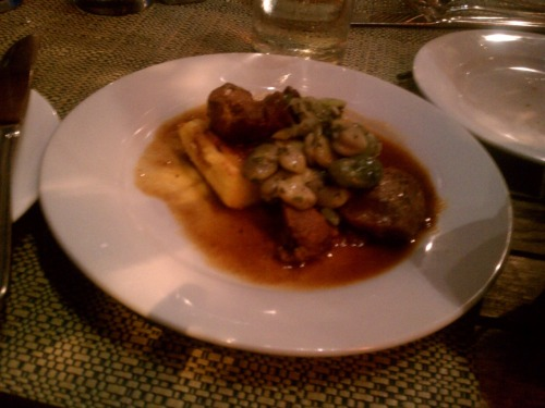 Braised pork cheeks with fava beans and corn bread at Cochon in New Orleans.