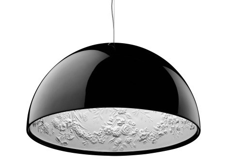 This pendent lamp is incredible.  Super chic and minimal from afar, but get under it to see an intricate hand-carved floral motif.  Perfect for over my future giant teak dining room table.