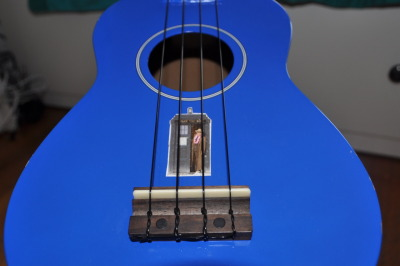 doctorwho:  A TARDIS Ukulele theplanetsbendbetweenus-:  the tardis landed and the doctor stepped out, he was somewhere that he had never been before…a ukulele.   OH SNAP. If I ever do get a ukelele, I officially am going to have to paint it TARDIS blue (or just buy one that color in the first place…) and name it TARDIS. Or something like that. XP