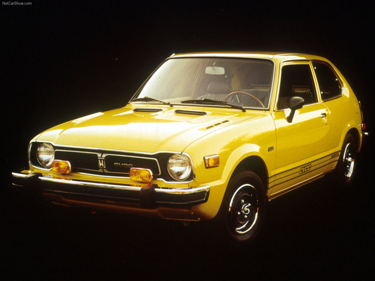 "1975 Honda Civic CVCC Honda began selling the 1169 cc (70 in) transversely mounted inline four-cylinder Civic for about US$2,200. The car produced roughly 50 hp and included power front disc brakes, vinyl seating, reclining bucket seats, and a woodgrain-accented dashboard. The hatchback version added a fold-down rear seat, an AM radio, and cloth upholstery. The car had front and rear independent suspension. A four-speed manual transmission was standard. Options for the Civic were kept to a minimum, consisting of air conditioning, an automatic transmission called the Hondamatic, radial tires, and a rear wiper for the hatchback. The car could achieve 40 mpg-US on the highway, and with a small 86.6 inch wheelbase and 139.8 inch overall length, the vehicle weighed only 1,500 pounds. In the USA, the advertising campaign used to introduce the Civic was, ""Honda, we make it simple."" The Civic outperformed American competitors such as the Chevrolet Vega and Ford Pinto. When the 1973 oil crisis struck, many Americans turned to economy cars. Reviews of American economy car quality were poor and getting worse due to spiraling costs for manufacturers. Japanese culture had a long-standing tradition of demanding high-quality economy cars, and the growing American desire in the 1970s for well-made cars that had good fuel mileage benefited the standing of Honda, Toyota, and Datsun in the lucrative U.S. market. For 1974, the Civic's engine size grew slightly, to 1237 cc and power went up to 52 hp. In order to meet the new 5 mph bumper impact standard, the Civic's bumpers grew 7.1 inches, increasing overall length to 146.9 inches. The CVCC (Compound Vortex Controlled Combustion) engine debuted in 1975 and was offered alongside the standard Civic engine. The optional 53 hp CVCC engine displaced 1488 cc and had a head design that promoted cleaner, more efficient combustion. The CVCC design eliminated the need for catalytic converters or unleaded fuel to meet changing emissions standards, unlike nearly every other U.S. market car. Due to California's stricter emissions standards, only the CVCC powered Civic was available in that state. A five-speed manual transmission became available this year, as did a Civic station wagon (only with the CVCC engine), which had a wheelbase of 89.9 inches and an overall length of 160 inches. Civic sales also increased and topped 100,000 units for this year. The first generation Honda Civics were notorious for rusting in less than three years from purchase where salt was used in the winter. The U.S. importer, American Honda Motor Company, signed a final consent decree with the Federal Trade Commission that provided owners of 1975-1978 Civics with rusted fenders the right to receive replacements or cash reimbursements. In the end, almost 1 million Honda owners were notified that their fenders could be repaired or replaced by the automaker at no charge. About 10% of all Hondas sold were to be inspected by a dealer, and the automaker had 180 days to replace front fenders and supporting parts that showed rust within the first three years of use. The Hondas were so vulnerable to corrosion that the National Highway Traffic Safety Administration (NHTSA) also issued a safety recall . This was because the car's lateral suspension arms, front crossbeam, and strut coil spring lower supports could weaken with exposure to salt. A total of 936,774 vehicles built between 9-1-1972 and 8-1-1979 were subject to extensive repairs since Honda had to replace the suspension components, or the automaker bought back entire cars with serious body corrosion. At the time, Honda's rust recall was the largest safety action among all the brands imported into the U.S. Civics became known for their ""typical Honda rust"" in the used car market."