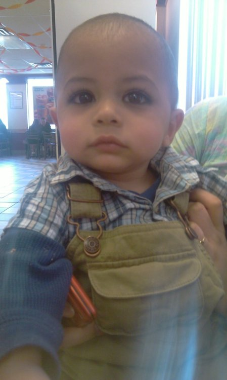 jabtakhaijaanhamari:  This is Zeeshan. He's 9 months old. The cutest baby boy I've ever met in my entire life. He laughed and smiled no matter what. He went into everyone's arms and loved playing outside. He was here in New York for 2 days and just left this morning to go back to Massachusetts. I just found out that he fell down 12 stairs in his walker. He went through a cat scan and the doctors have found out that he has a cracked skull. They've now sent him to Boston Hospital, which is about 2 hours away from where his family lives. Please pray for this adorable child and reblog. =( Insha'Allah Allah (SWT) will give him strength. <3
