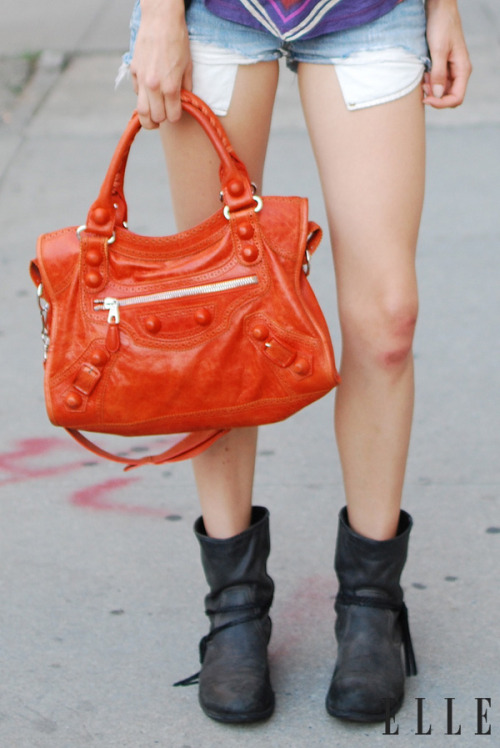 Street Chic: New York  Tote a spring bag in an eye-catching color this season.  Photo: Courtney D'Alesio