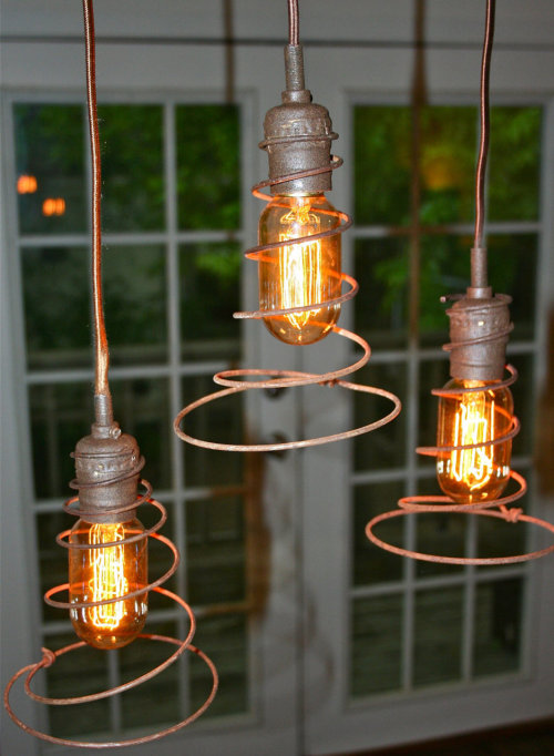 Via route11vintage:  Upcycled bed spring hanging lights @ http://www.etsy.com/shop/Urbanhardware  For other things-repurposed-as-lighting ideas, scroll through the set of Unconsumption posts here.