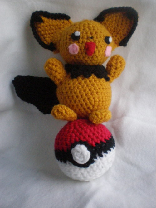 PIKACHU-COLORED PICHU :D + another pokeball * I have an obsession with shiny pokemon annnd I also didn't have quite as light yarn so I just worked with what I had.  Sooo after a long struggle with this pattern which I started at the beginning of the semester, it is done! It wasn't particularly difficult, just slightly time consuming with putting all the pieces together and I haven't had much time at college. But now that I'm home, hopefully more to come soon! And it's funny how little yarn amigurumi uses - barely put a dent in my yellow yarn stash. Pattern used: http://wolfdreamer-oth.blogspot.com/2009/05/pichu-plush.html Thinking I need to get more different colors of yarn or maybe make a mudkip since I have lots of orange and blue xD