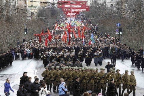 fuckyeahrussianpolitics:  People take part in a festive procession to mark the Victory Day during  in the northern city of Murmansk May 9, 2011. Russia celebrates the 66th  anniversary of the World War Two victory over Nazi Germany.