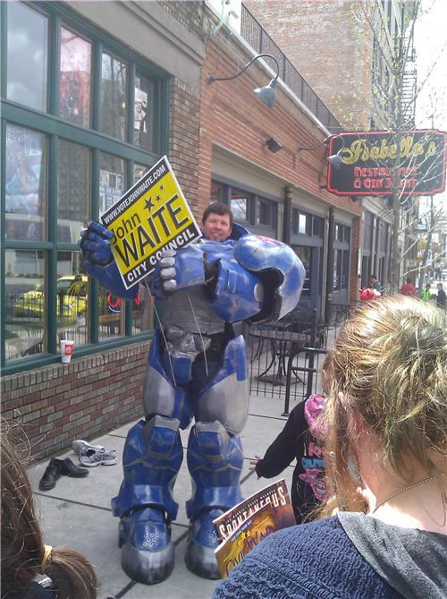 Man Runs for Spokane City Council in Starcraft Marine Suit John Waite is the owner of the comic book shop Merlyn's, and he's going to be running for city council in Spokane, Washington in a Starcraft Marine suit. Waite started wearing the costume on Free Comic Day, which was last Saturday. (via: reddit, tdwgeeks)