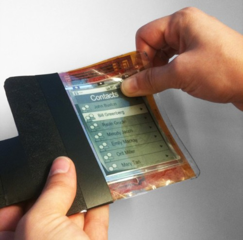 scribnerbooks:  laughingsquid:  The PaperPhone, A Flexible Screen Smartphone  If you're still freaked out about e-readers, wait until you can fit The Great Gatsby in the pocket of your jeggings.  Um… whoa.
