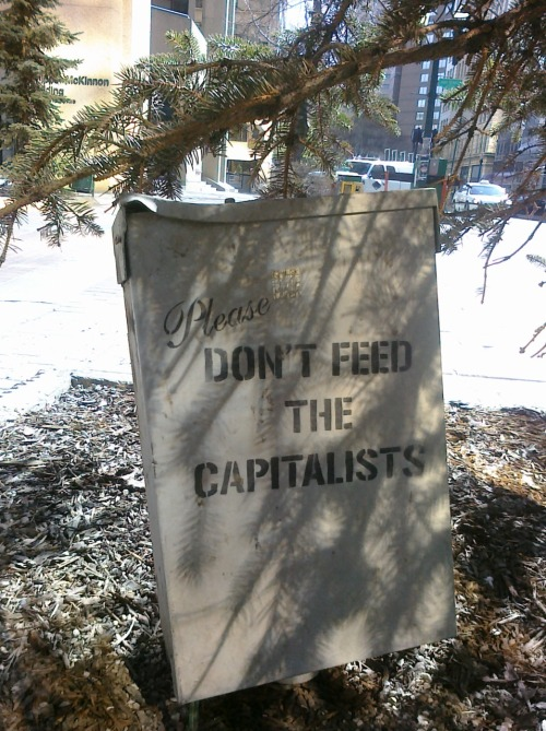 'Please don't feed the capitalists' found this on Rice Howard Way #yeg #streetart