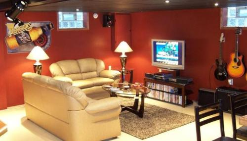 "The ""Man Cave"" is viewed as the epitome of manhood. Nothing brings more pride, other than family, to a man's heart than having an amazing Man Cave. Ever since we lived within caves ourselves those many years ago, men have felt a liking for caves. Whether it be the beautiful cave every women has genetically…I will pause until you understand what I mean…Or having a place of our own dubbed the Man Cave. What does it take to have the ultimate Cave? Well little details can vary but the meat and potatoes of the Cave should all be the same. An awesome HDTV! How do you expect to have a Cave without the main ingredient? The TV is what pulls the room together, ideally it should be placed in the center of the room. And yes, the bigger the better. In today's world it's so easy to get a great sized HDTV that you have no excuse not to have one. Only real men have bad-ass HDTV's! Videos Games Man! Men love video games and I hope you've got some in your Cave. Whether it be the 360, PS3, or the Wii. I don't care what it is as long as you've got some bad-ass games to play in HD on that bad-ass TV! Surround Sound. Ideally you'll want a 5.1 Dolby Digital surround sound system for extreme bass and treble in everything you hear. Your ears should be having an orgasm at least 3 times an hour. Comfortable seating. You know those awful seats at the move-theater? Well you don't want that crap in your Cave! Make sure you've got something to keep you comfortable for up to hours on end boy! Lastly, a computer! The Man Cave has evolved drastically in the past five years so I expect you to adapt yours for the future. With the ability to now sync our computers with our game consoles and HDTV's. A great computer is almost as important as the TV itself. As well, you can look up all the ""content"" you want with a quick Google search if you get what I mean. The final point is optional, but it is a dream to have in any Man Cave. The legendary Mini-Fridge. With the ability to house your refreshments, or subs, you no longer need to worry about missing anything important on the big screen. If your Man Cave consists of everything on this list, then you sir, are a legend. I respect the ultimate room you have established and congratulate your amazing feat that many men aspire to achieve one-day."