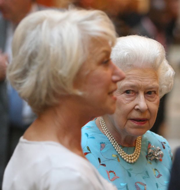 Photo of Queen Elizabeth looking at actress Helen Mirren during a reception to honour young people in performing arts at Buckingham Palace