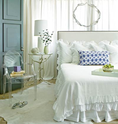 A sophisticated bedroom with a bit of frill and feminine touches.  (But in a good way!)