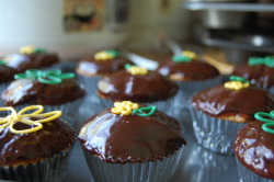 Homecoming Cupcakes. -Vanilla Cupcake  - Dark Chocolate Ganache frosting