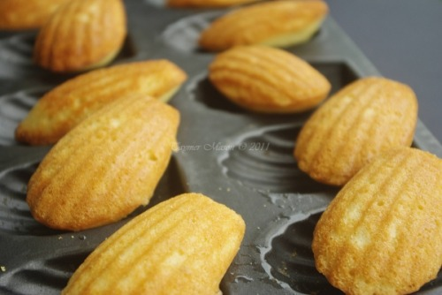 I love Madeleines. They make me feel fancy. (But make sure that sugar is raw!) yummyvegan:  Vegan Madeleines Ingredients 2 ½ tablespoon flax meal ¼ cup hot water 2 tablespoon plain vegan yogurt 150 g granulated sugar 125 g melted vegan butter A few drops of yellow food dye Zest of one lemon ½  teaspoon vanilla extract 160g unbleached all purpose flour 2 tablespoons non dairy milk Method Preheat oven to 350°F. Grease and generously flour the scalloped pan. Mix hot water with flax meal and stir for 30 seconds. Let this mixture rest for 1 minute. Strain the flax mixture to separate the grainy strong flavor flax  seeds. Stir in yogurt, sugar,butter,food dye,zest of lemon and vanilla extract. Slowly add the flour and mix well. Add milk and mix well. The batter should be fairly stiff. Fill Madeleine pans ¾ ways up and bake at 350°F for  7 minutes. Reduce heat and cook at 250 F for another 8 minutes. Turn off the heat in the oven and leave Madeleines inside for 20 minutes. Cool and serve with espresso or tea.