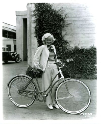 "Reminds me I need to rent ""Platinum Blonde"" again ridesabike:  Jean Harlow walks a bike."