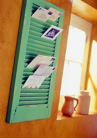 Shutter Mail Organizer | Ahhhh… blog  Super easy DIY! This one is useful, sustainable, recyclable and biodegradable.  Paint a window shutter any color you like and use a hook to hang it or if you are not  'handy' use heavy duty Velcro to attach to the wall.