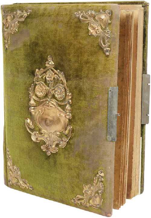 What a beautiful old book, I wonder what's inside? [EDIT:] Apparently it is an old photo album from the very late 1800s/early 1900s.