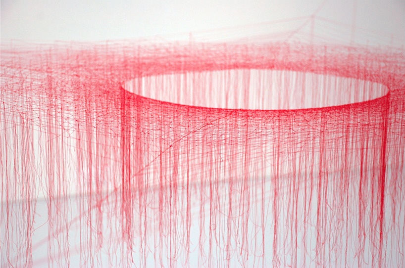 akiko ikeuchi, silk vortex, knotted thread-red'  exhibition at the museum of contemporary art tokyo via designboom