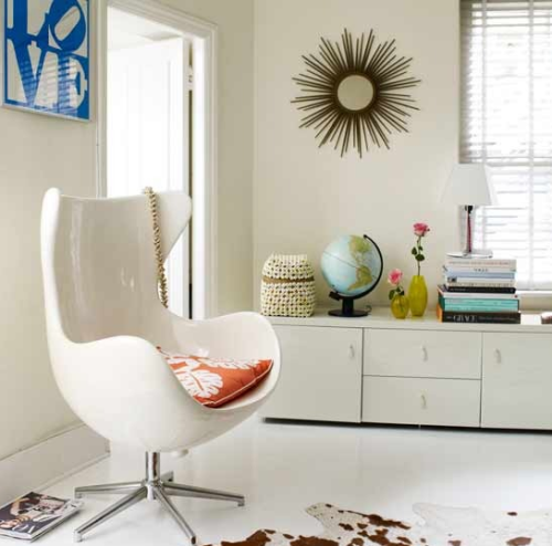 A chic, boho, mid century inspired room.  Love the clean, bright, white feel!